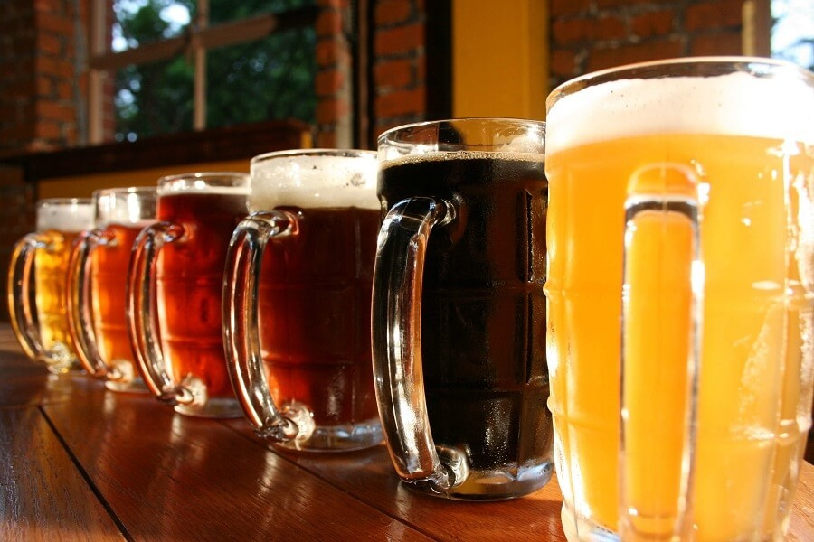 pitchers of different types of beer